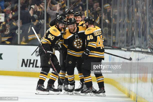 Steven Kampfer of the Boston Bruins celebrates his goal with his line mates against the Carolina Hurricanes in Game One of the Eastern Conference...