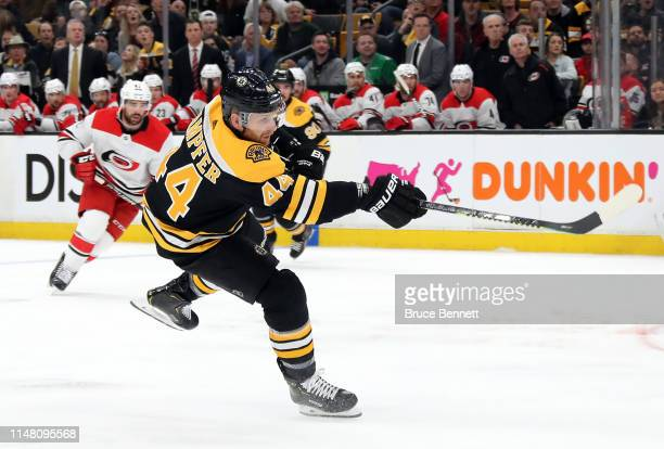 Steven Kampfer of the Boston Bruins scores a goal during the first period against the Carolina Hurricanes in Game One of the Eastern Conference Final...
