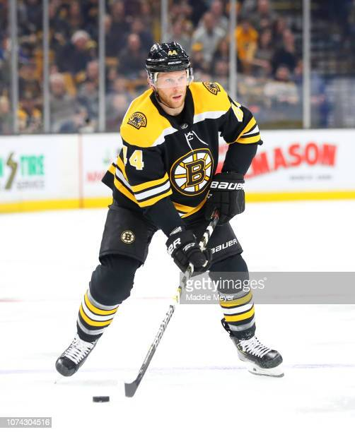 Steven Kampfer of the Boston Bruins skate against the Buffalo Sabres in the first period of the game between the Boston Bruins and the Buffalo Sabres...