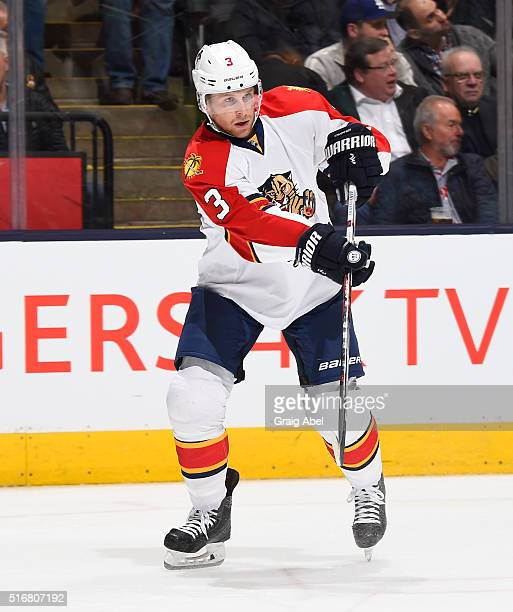 Steven Kampfer of the Florida Panthers fires a pass up ice against the Toronto Maple Leafs during game action on March 17 2016 at Air Canada Centre...