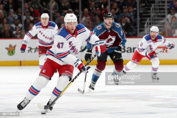 Steven Kampfer of the New York Rangers brings the puck down the ice against the Colorado Avalanche at the Pepsi Center on January 20 2018 in Denver...