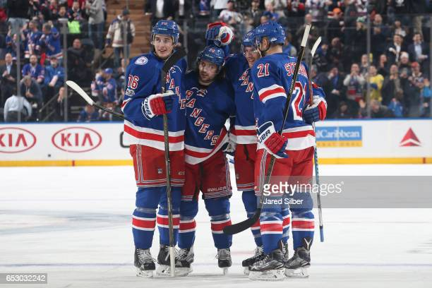 Steven Kampfer of the New York Rangers celebrates his goal in the first period with teammates Brady Skjei Mats Zuccarello and Derek Stepan against...