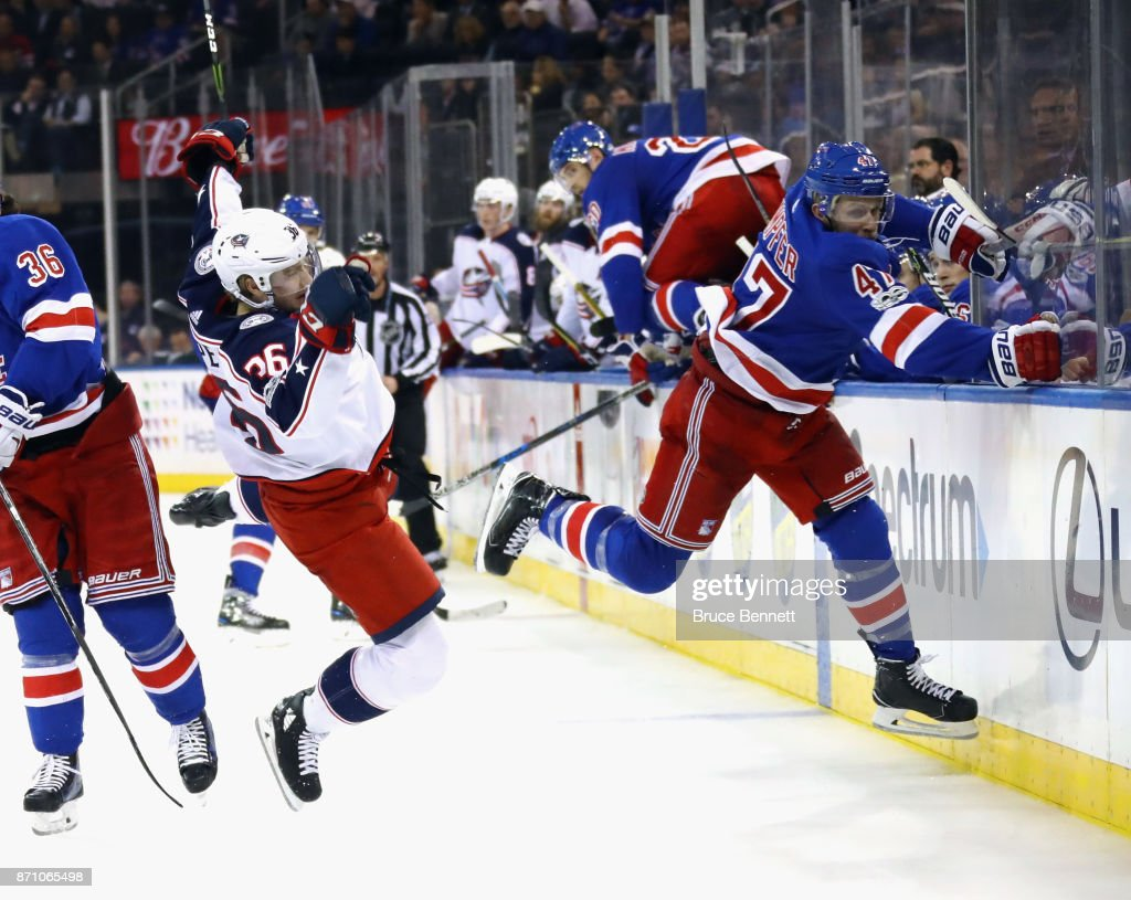 Steven Kampfer #47 of the New York Rangers hits Zac Dalpe #36 of the Columbus Blue Jackets during the third period at Madison Square Garden on November 6, 2017 in New York City. The Rangers defeated the Blue Jackets 5-3.