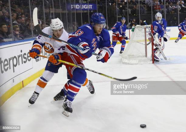 Steven Kampfer of the New York Rangers is held back by Anthony Beauvillier of the New York Islanders during the third period at Madison Square Garden...