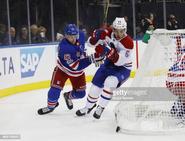 Steven Kampfer of the New York Rangers pursues Charles Hudon of the Montreal Canadiens during the third period at Madison Square Garden on October 8...
