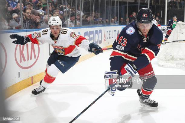 Steven Kampfer of the New York Rangers skates against Jonathan Marchessault of the Florida Panthers at Madison Square Garden on March 17 2017 in New...