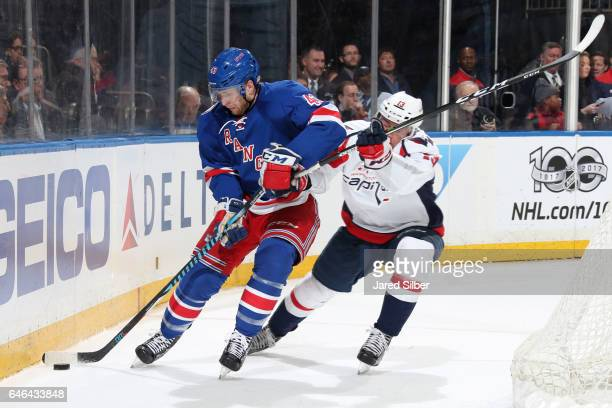 Steven Kampfer of the New York Rangers skates with the puck against Jakub Vrana of the Washington Capitals at Madison Square Garden on February 28...