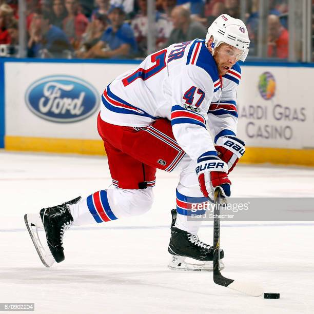 Steven Kampfer of the New York Rangers skates with the puck against the Florida Panthers at the BBT Center on November 4 2017 in Sunrise Florida