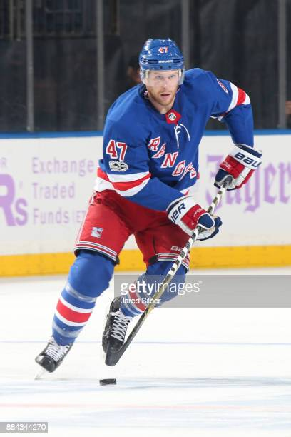 Steven Kampfer of the New York Rangers skates with the puck against the Florida Panthers at Madison Square Garden on November 28 2017 in New York...