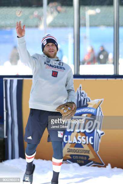 Steven Kampfer of the New York Rangers throws a baseball prior to warm ups during the 2018 Bridgestone NHL Winter Classic against the Buffalo Sabres...