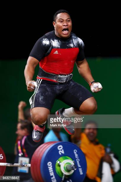 Steven Kari of Papua New Guinea celebrates victory during Weightlifting on day four of the Gold Coast 2018 Commonwealth Games at Carrara Sports and...