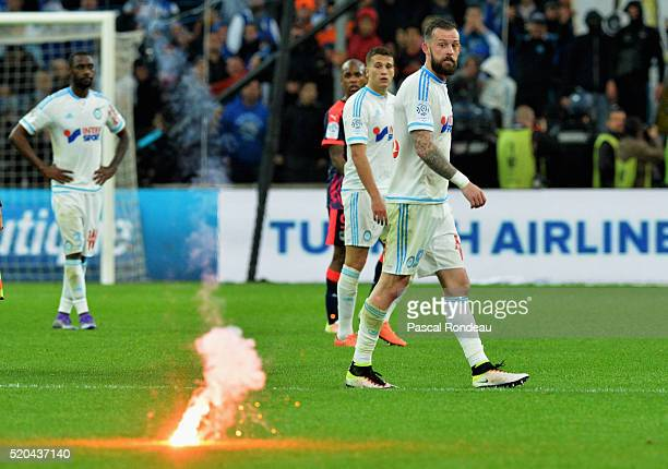 Steven Kenneth FletcherJavier Manquillo and Nicolas Nkoulou from Marseille received a smoke shell at the end of the match during the French League 1...