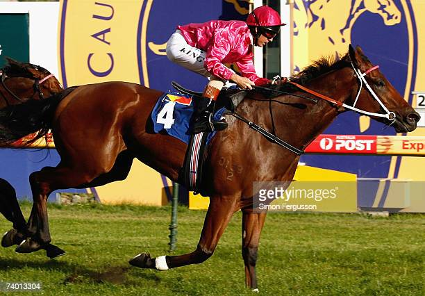 Steven King riding Posadas crosses the line to win the Pink Ribbon Cup at Caulfield Racecourse April 28 2007 in Melbourne Australia