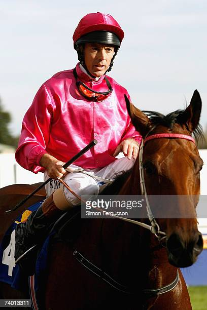 Steven King riding Posadas trots in to the winners circle after winning the Pink Ribbon Cup at Caulfield Racecourse April 28 2007 in Melbourne...