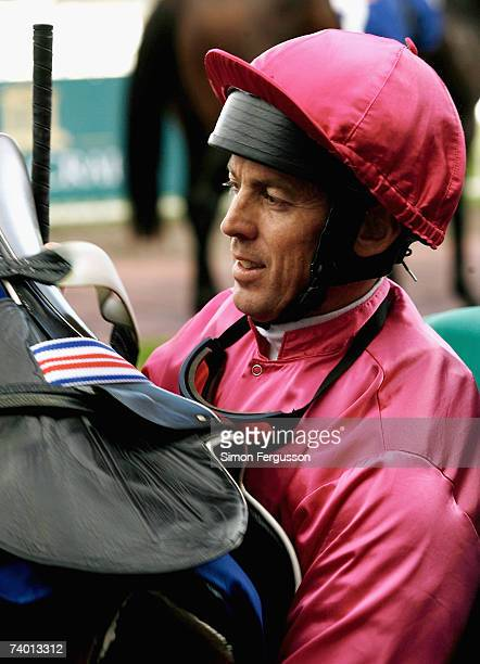 Steven King who rode Posadas removes his horses saddle after winning the Pink Ribbon Cup at Caulfield Racecourse April 28 2007 in Melbourne Australia