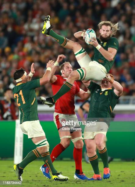 Steven Kitshoff of South Africa helps teammate RG Snyman win a high ball under pressure from Alun Wyn Jones of Wales during the Rugby World Cup 2019...