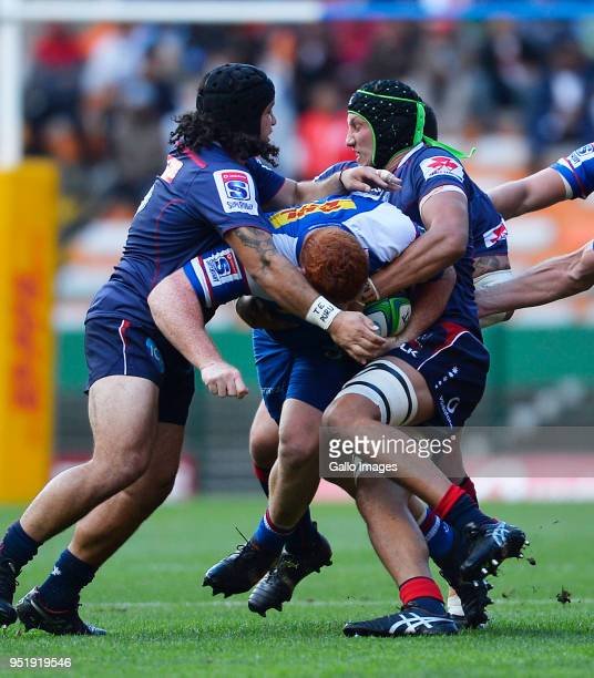 Steven Kitshoff of the Stormers tackled by Anaru Rangi of the Rebels and Adam Coleman of the Rebels during the Super Rugby match between DHL Stormers...