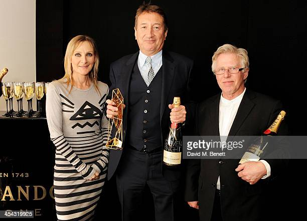 Steven Knight winner of the Best Screenplay award for 'Locke' poses with presenters Lesley Sharp and Phil Davis pose backstage at the Moet British...