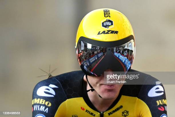Steven Kruijswijk of Netherlands and Team Jumbo - Visma and a dragonfly perched on its shoulder cross the finishing line during the 76th Tour of...