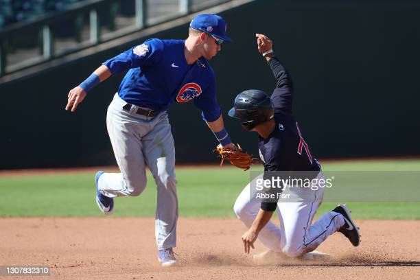Steven Kwan of the Cleveland Indians steals seocnd base against D.J. Snelten of the Chicago Cubs in the seventh inning during their MLB spring...