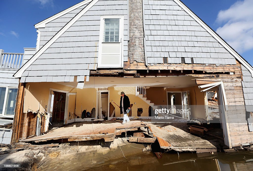 Steven Lawit recovers items from his destroyed home on November 21, 2012 in Mantoloking, New Jersey. Mantoloking was one of the hardest hit areas by Superstorm Sandy.