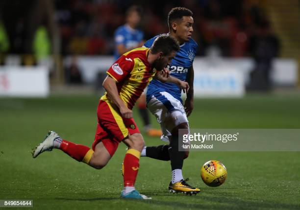 Steven Lawless of Partick Thistle vies with James Tavernier of Rangers during the Betfred League Cup Quarter Final at Firhill Stadium on September 19...