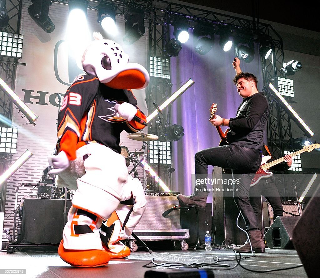 Steven Lee Olsen is joined on stage by Anaheim Wild Ducks mascot Mighty Wing during a performance on the Honda Stage at the NHL Fan Fair presented by Bridgestone at the Music City Center,on January 29, 2016 in Nashville, Tennessee.