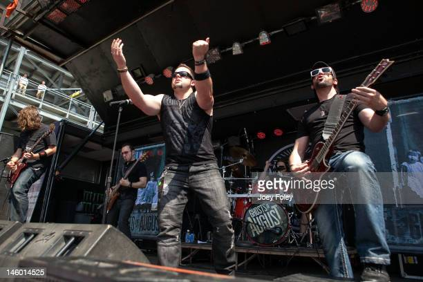 Steven Lee Terry Freers Dave Holowchak Kenny Lee and Paul Delmotte of Ghosts of August perform live during the 2012 Rock On The Range festival at...
