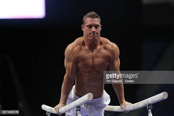 Steven Legendre Norman Oklahoma shows his muscles and physique during warm up on the Parallel bars before competiton during the Senior Men...