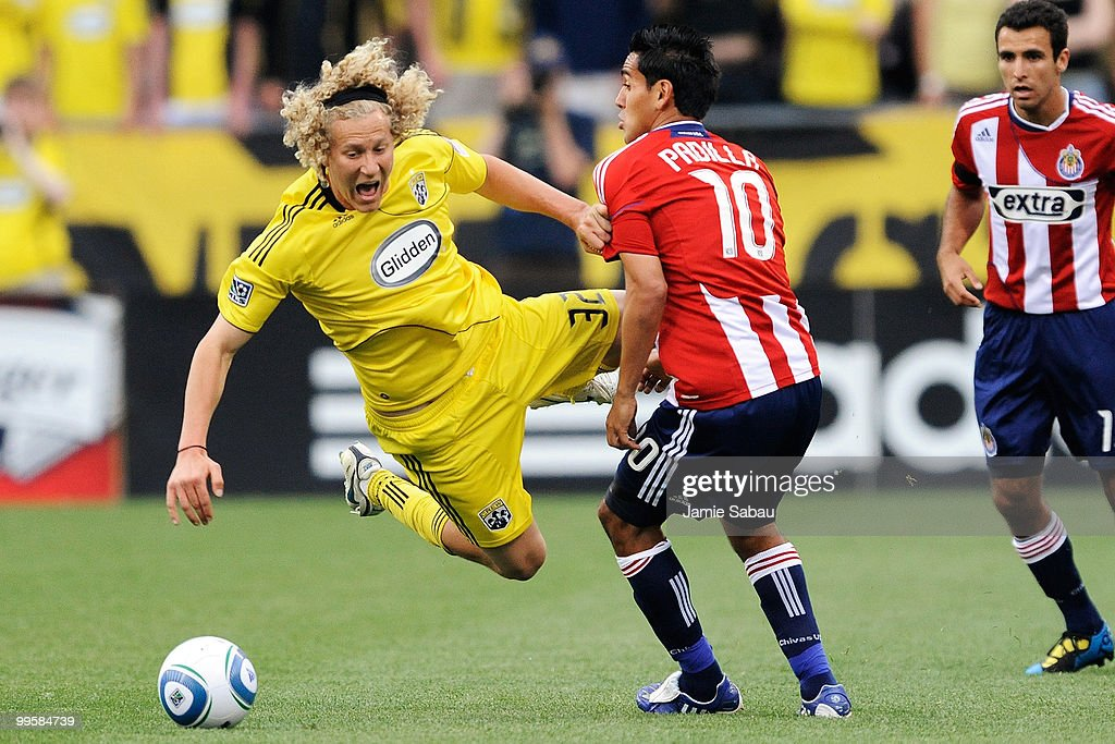 Steven Lenhart #32 of the Columbus Crew is upended by Jesus Padilla #10 of Chivas USA on May 15, 2010 at Crew Stadium in Columbus, Ohio.