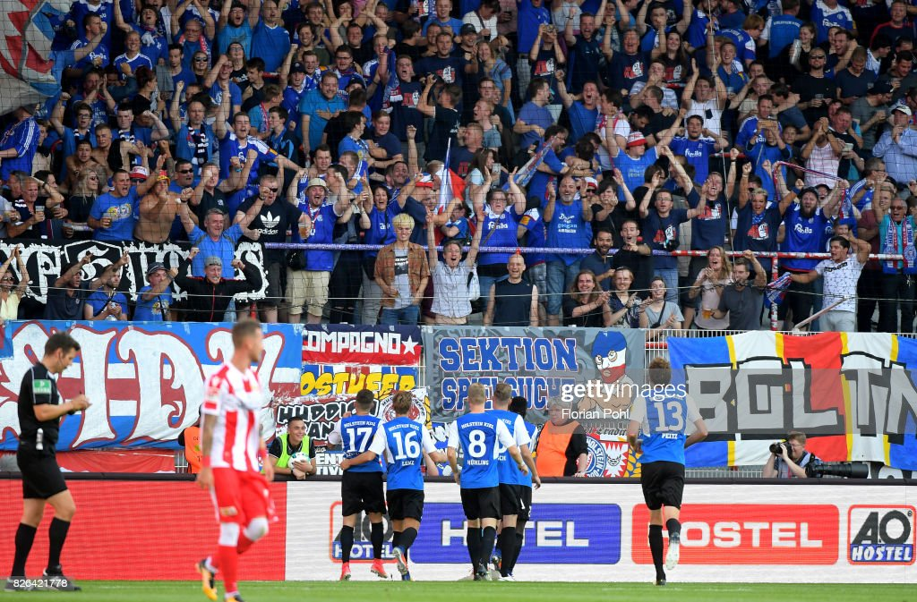 Steven Lewerenz, Christopher Lenz, Alexander Muehling and Dominic Peitz of Kieler SV Holstein celebrate after scoring the 3:3 during the game between Union Berlin and Kieler SV Holstein on august 4, 2017 in Berlin, Germany.