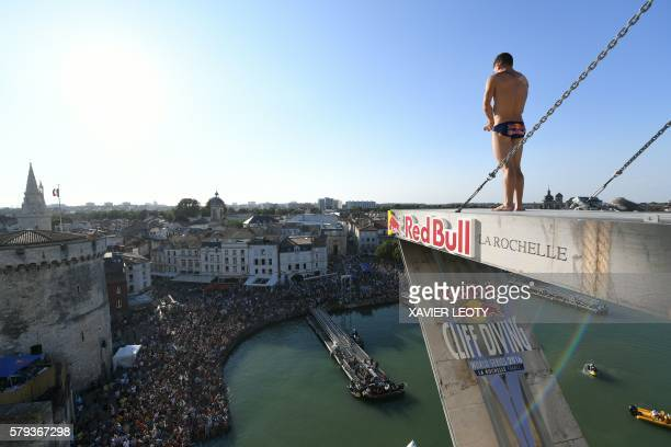 Steven Lobue from USA prepares to dive from the 275 metre high platform on the SaintNicolas tower during the Red Bull Cliff Diving World Series on...