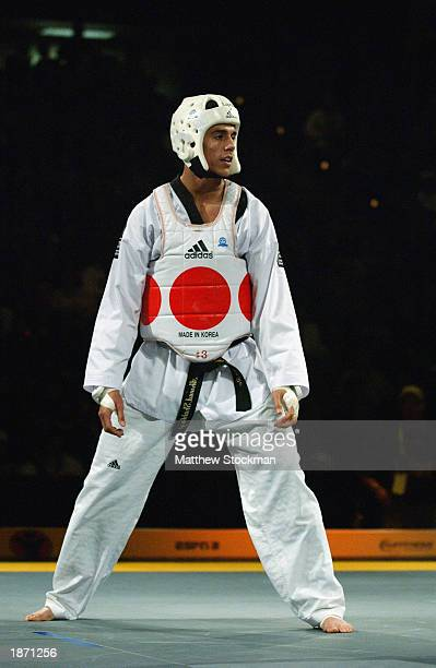 Steven Lopez fights Seon-taek Oh of Korea in Taekwondo during the Titan Games on February 15, 2003 at the Event Center at San Jose State University...