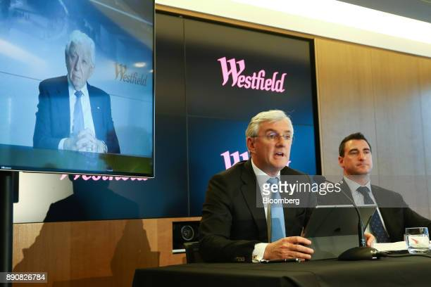 Steven Lowy cochief executive officer of Westfield Corp seated left speaks as Elliott Rusanow chief financial officer looks on while billionaire...