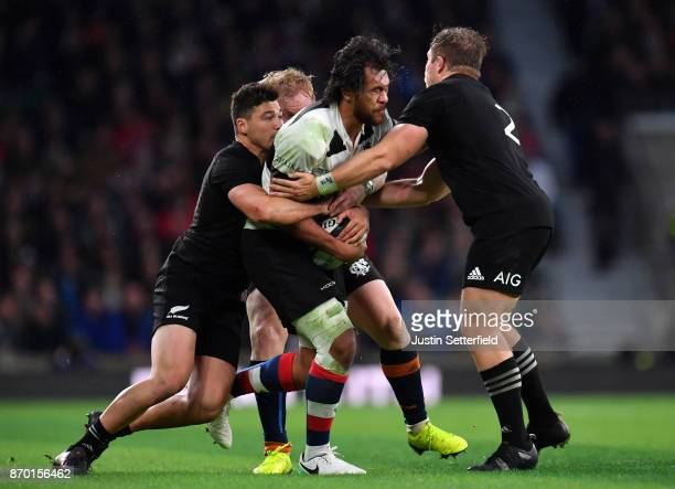 Steven Luatua of Barbarians is tackled by David Havili of New Zealand and Nathan Harris of New Zealand during the Killik Cup between Barbarians and...