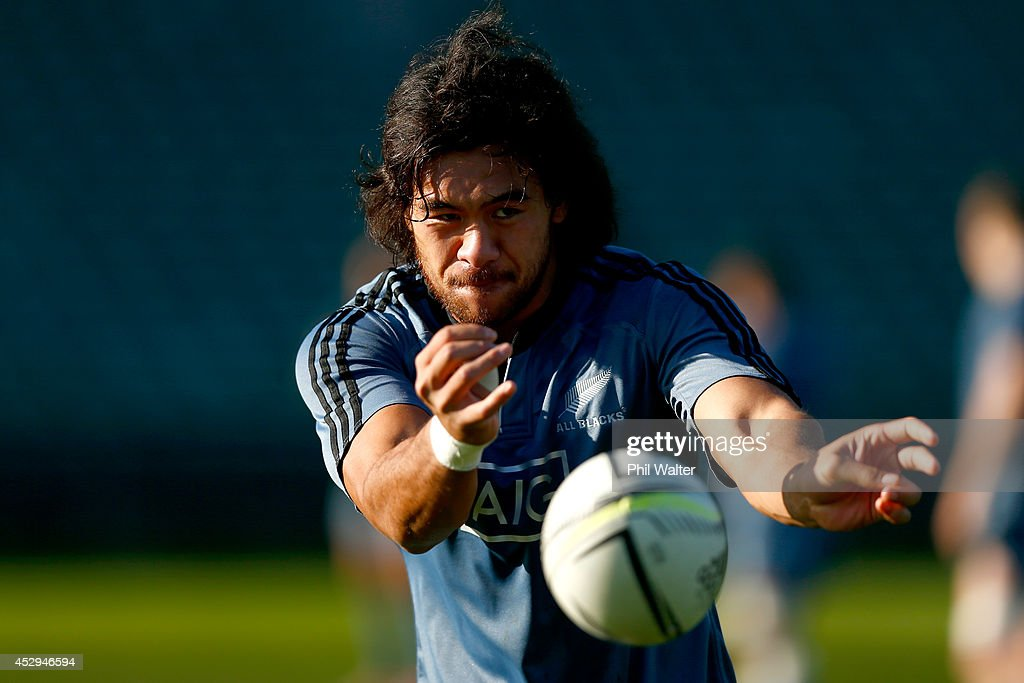 Steven Luatua of the All Blacks passes during a New Zealand All Blacks training session at North Harbour Stadium on July 31, 2014 in Auckland, New Zealand.
