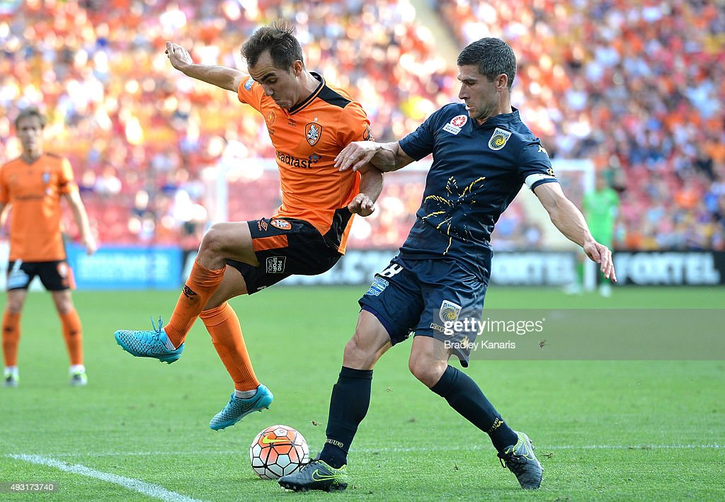 Steven Lustica of the Roar and Nick Montgomery of the Mariners challenge for the ball during the round two A-League match between the Brisbane Roar and Central Coast Mariners at Suncorp Stadium on October 18, 2015 in Brisbane, Australia.