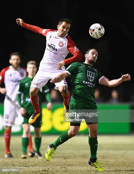 Steven Lustica of the Wanderers heads the ball over the top of Nicholas Ward of Bentleigh during the round of 16 FFA Cup match between Bentleigh...