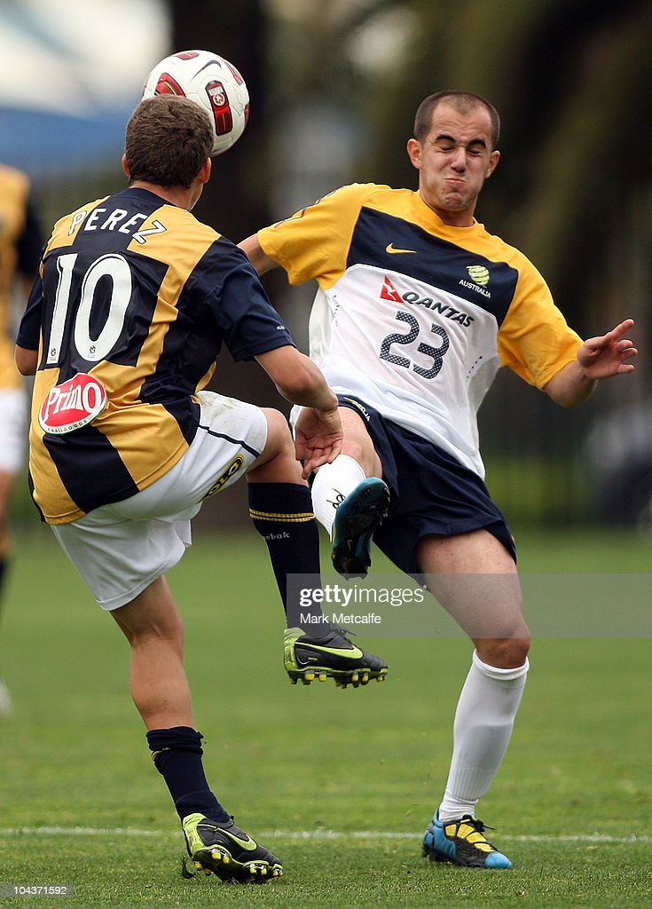 Steven Lustica of the Young Socceroos and Patricio Perez of the Mariners compete for the ball during the friendly match between the Young Socceroos and the Central Coast Mariners at Bluetongue Stadium on September 23, 2010 in Gosford, Australia.