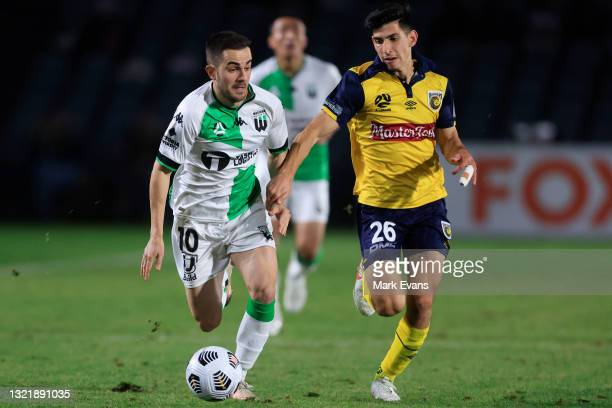 Steven Lustica of United is challenged by Jaden Casella of the Mariners during the A-League match between Central Coast Mariners and Western United...
