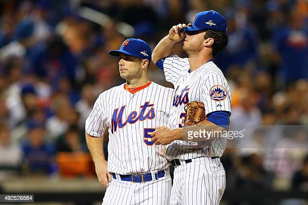 Steven Matz and David Wright of the New York Mets react after giving up a run in the third inning against the Los Angeles Dodgers during game four of...