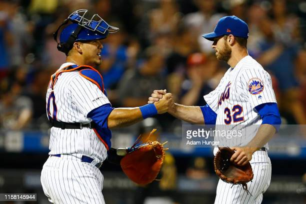 Steven Matz of the New York Mets and Wilson Ramos of the New York Mets celebrate after defeating the Pittsburgh Pirates at Citi Field on July 27,...
