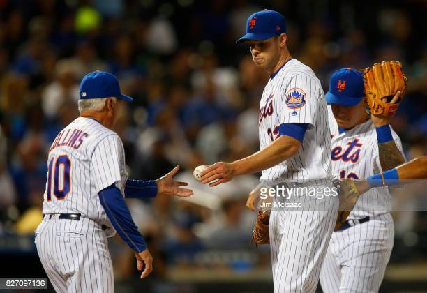 Steven Matz of the New York Mets hands the ball to manager Terry Collins as he is removed from a game against the Los Angeles Dodgers in the sixth...
