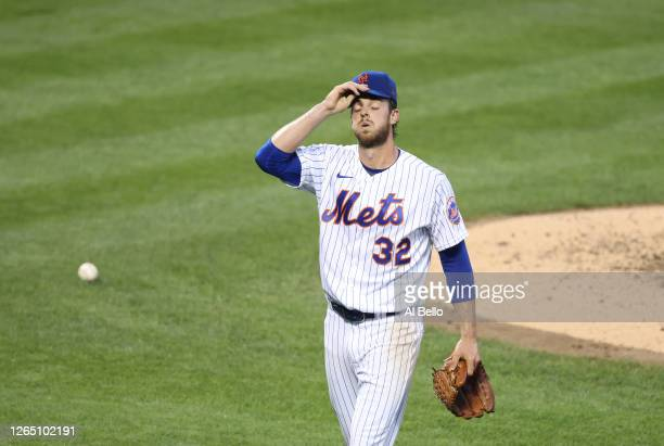 Steven Matz of the New York Mets heads to the dugout after giving up 4 runs against the Washington Nationals in the third inning during their game at...