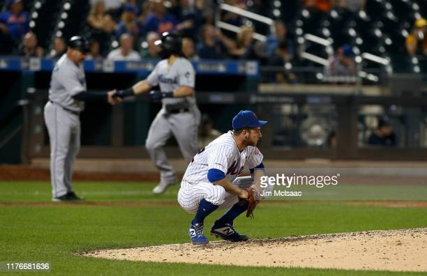 Steven Matz of the New York Mets reacts on the mound after surrendering a sixth inning grand slam home run against Jorge Alfaro of the Miami Marlins...