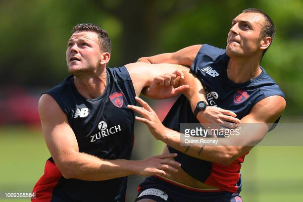 Steven May and Braydon Preuss compete for the ball during a Melbourne Demons AFL training session at Gosch's Paddock on November 19 2018 in Melbourne...