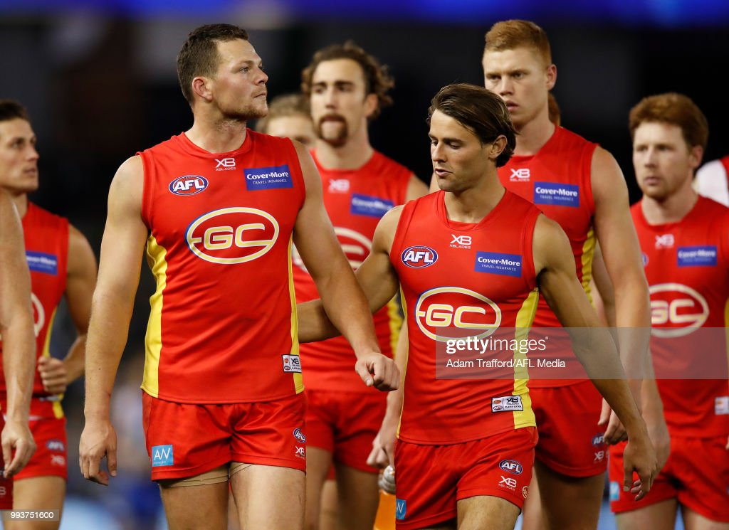 Steven May (left) and Sean Lemmens of the Suns look dejected after a loss during the 2018 AFL round 16 match between the North Melbourne Kangaroos and the Gold Coast Suns at Etihad Stadium on July 08, 2018 in Melbourne, Australia.