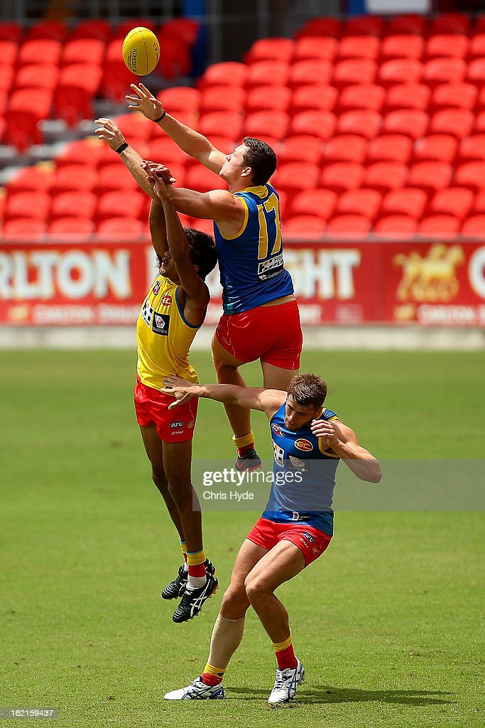 Steven May attempts a mark during a Gold Coast Suns AFL training session at Metricon Stadium on February 20, 2013 in Gold Coast, Australia.