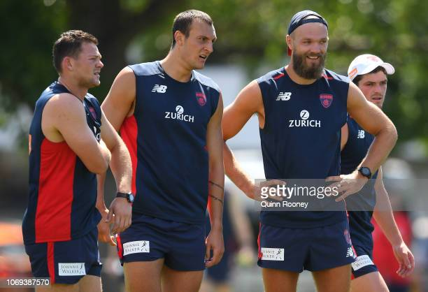Steven May Braydon Preuss and Max Gawn of the Demons look on during a Melbourne Demons AFL training session at Gosch's Paddock on November 19 2018 in...