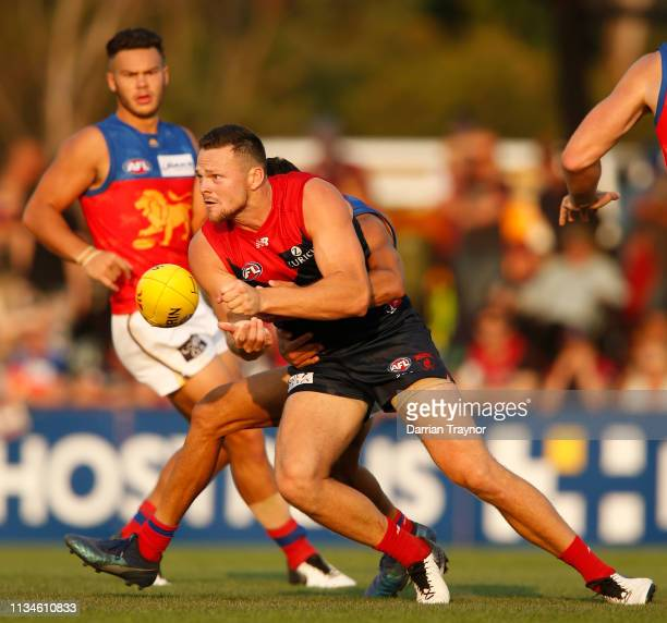 Steven May of the Demons handballs during the 2019 JLT Community Series AFL match between the Melbourne Demons and the Brisbane Lions at Casey Fields...